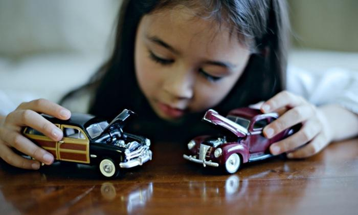 Girl plays with toy cars
